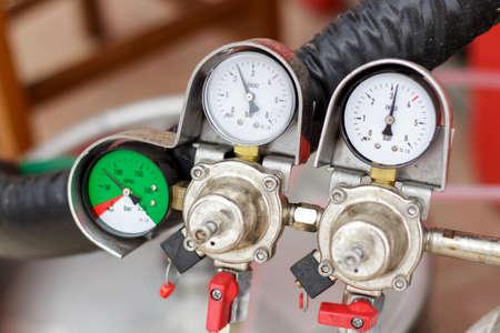 Nanometers of the nitrogen pressure regulator system on a draft beer faucet