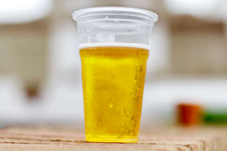 draft beer: Glass of plastic with draft beer