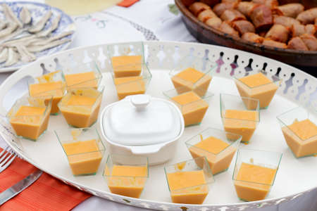 andalusian cuisine: Tray of canapes of salmorejo beside spanish sausage and anchovies fillets Stock Photo