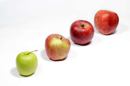 disposed: Apples disposed in row, on white background