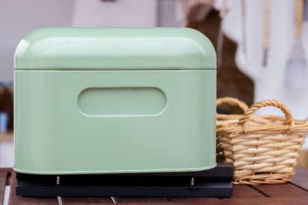 metal box: Green metal box for crockery in a kitchen Stock Photo