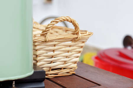 osier: Small wicker basket behind a green metal box for crockery