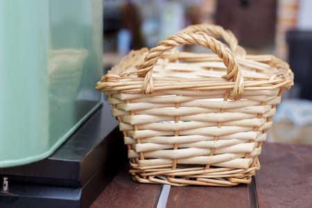 osier: Small wicker basket beside a green metal box for crockery