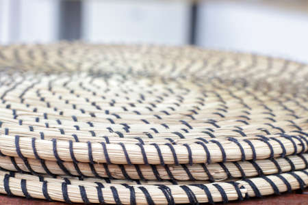 trivet: Detail view of several round trivet made of wicker