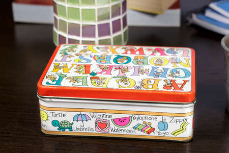 metal box: Small metal box with drawings of toy bears for vocabulary learning