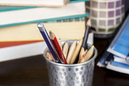 pencil case: Several wooden pencils into a metal pencil case on a desk Stock Photo