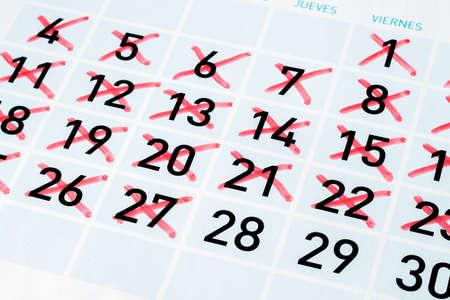 Calendar page with strikethrough days