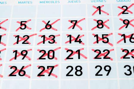strikethrough: Calendar page with twenty seven strikethrough days