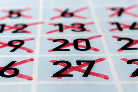 strikethrough: Calendar page of a past month with strikethrough numbers Stock Photo