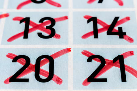 strikethrough: Detail of strikethrough numbers of a calendar page Stock Photo