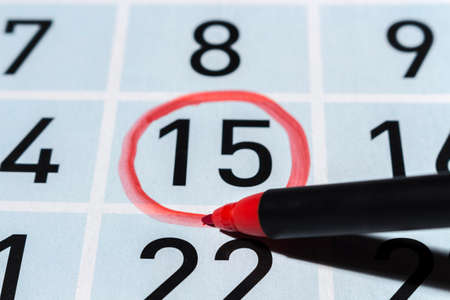 emphasis: Drawing a red circle on the fifteenth day of the month Stock Photo