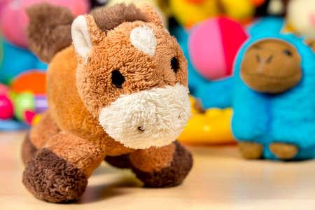 burro: burro de peluche en frente de otros animales de peluche y juguetes para beb�s