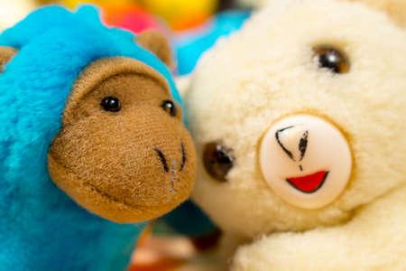babyhood: Blue stuffed monkey embraced to teddy bear. Friendship Stock Photo