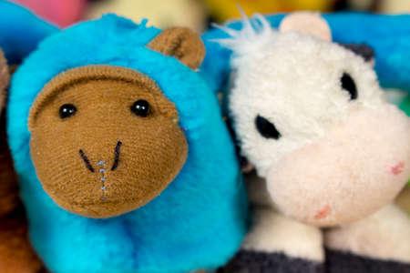 babyhood: Blue stuffed monkey embraced with teddy cow. Friendship. Stock Photo