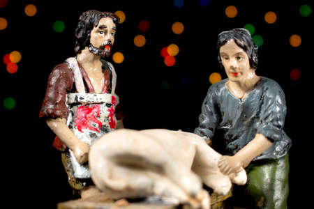 adoration: Shepherds in the Adoration of the Child. Nativity scene figurines. Christmas traditions.