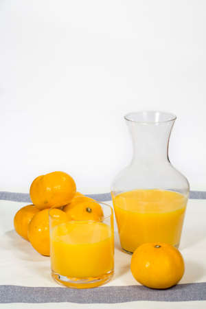 glass jar: Glass jar with natural orange juice Stock Photo
