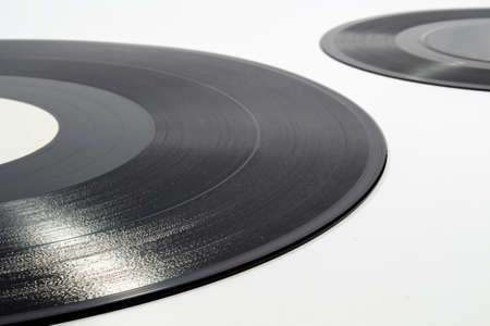 audiophile: Detail of inscribed spiral groove of a vinyl record on white