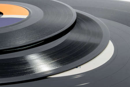 audiophile: Detail of grooves on vinyl records of different sizes