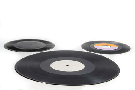 audiophile: Three vinyl records of different sizes on white background