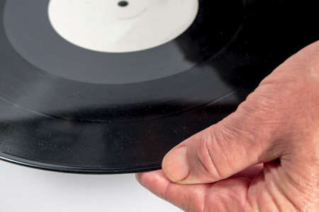 audiophile: The hand of a man holding a vinyl record