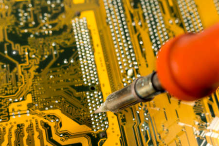 soldering: Repairing a damaged motherbard with a  soldering iron