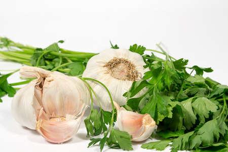 petroselinum sativum: Garlic and parsley, on white background Stock Photo