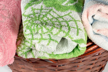 hand towel: Close-up of green and white hand towel into a wicker basket Stock Photo