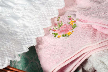 hand towel: Detail of the embroidery of a pink hand towel