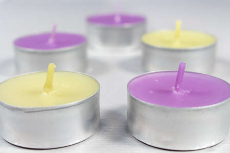 vax: Small scented candles with metal base, light green (apple fragrance) and purple (lilac fragrance)