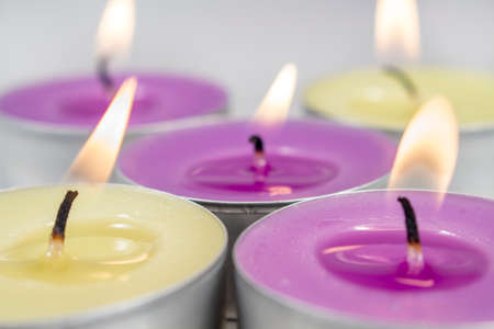 vax: Close-up of scented candles with metal base of different colors and fragrances (green apple and lilac)