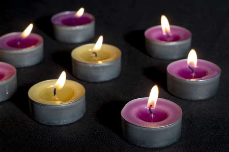 vax: Small scented candles with metal base, smelling lilacs and green apples, on dark floor