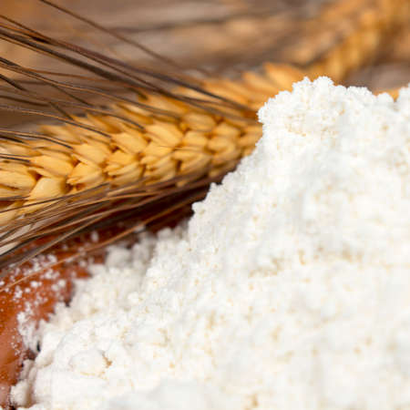 staple: A heap of wheat flour beside spikes of this kind of cereal. Staple foods.
