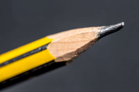 wooden pencil: The graphite tip of a wooden pencil on gray