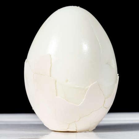 boiled egg: Half-peeled boiled egg