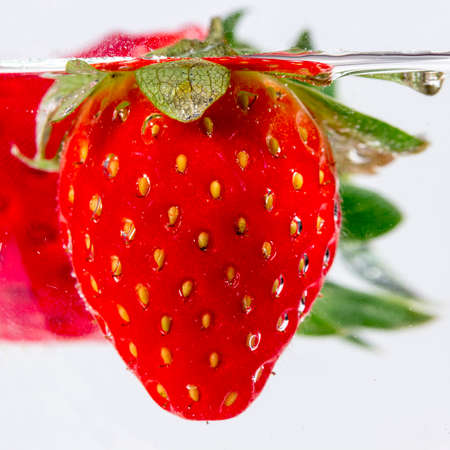 submerged: Strawberry submerged into a water glass