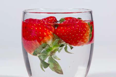 submerge: Washing strawberries with water
