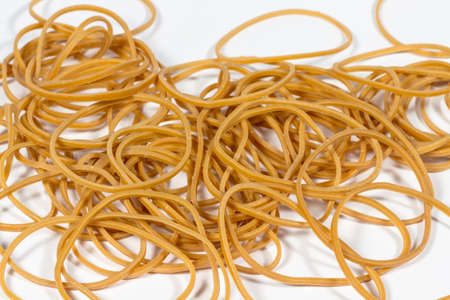 vulcanization: Heap of natural rubber bands on white Stock Photo