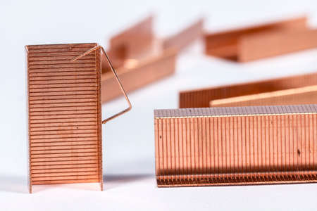 metal fastener: Copper staples on white Stock Photo