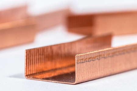 metal fastener: Piles of staples on white Stock Photo