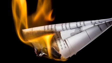 suppress: Burning documents. Suppress incriminating evidences Stock Photo