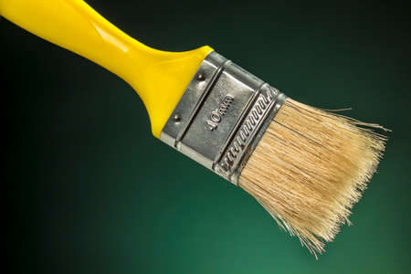 bristle: Decorator brush with yellow handle and horse hair bristle Stock Photo