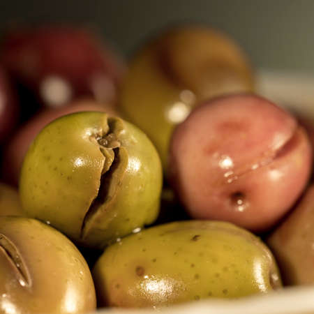 seasoned: Slit and cracked olives, seasoned with a traditional andalusian recipe Stock Photo