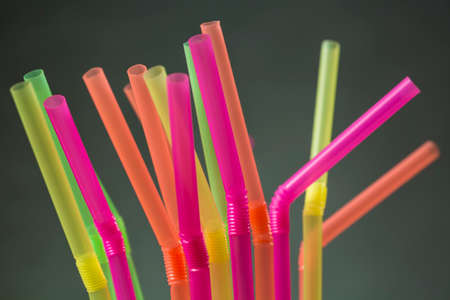 Top of several drinking straws made of plastic with different colors