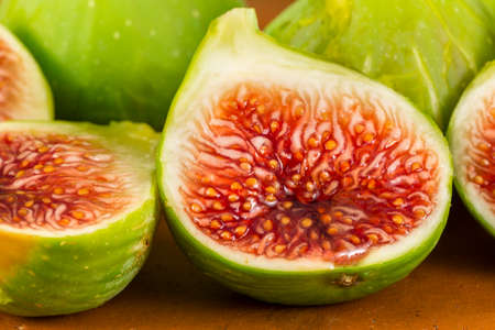 Seeds and red flesh of fresh figs cut in half Stock Photo