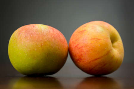 Traditional variety of small and delicious green and red apples originating from the south of Spain Stock Photo