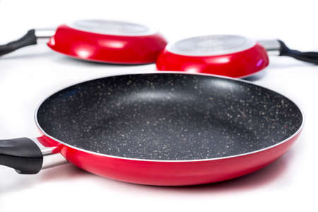 Induction frying pans made of aluminium with marble coating. On white.
