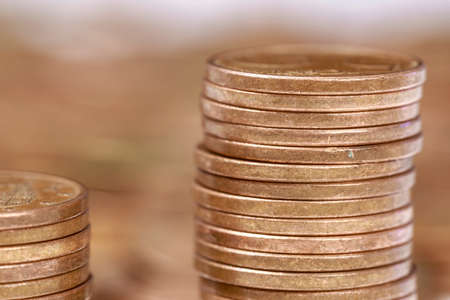 Close-up of piles of Euro cent coins of different heights