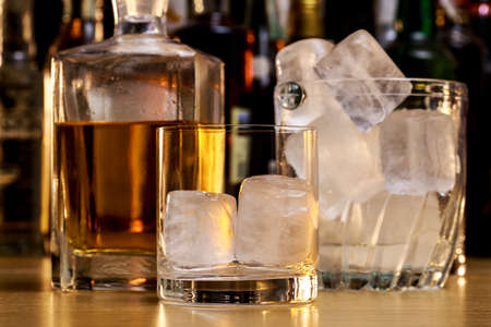 Preparing a whisky on the rocks
