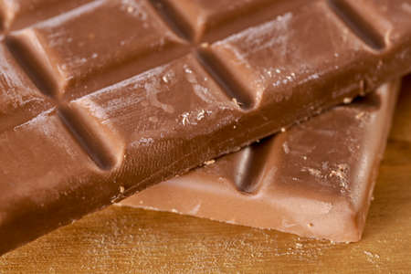 Close-up of chocolate ounces, on wooden floor Stock Photo