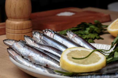 engraulis encrasicolus: Cooking delicious small anchovies, known in Andalusian gastronomy as boquerones. Mediterranean diet
